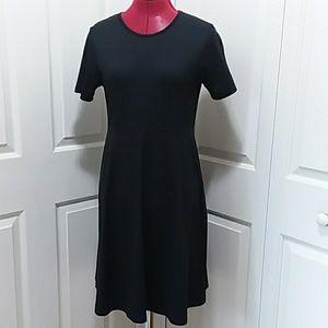 L L Bean Traveler black pull on skater dress